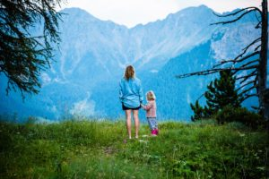 Mother and daughter walking in moutains